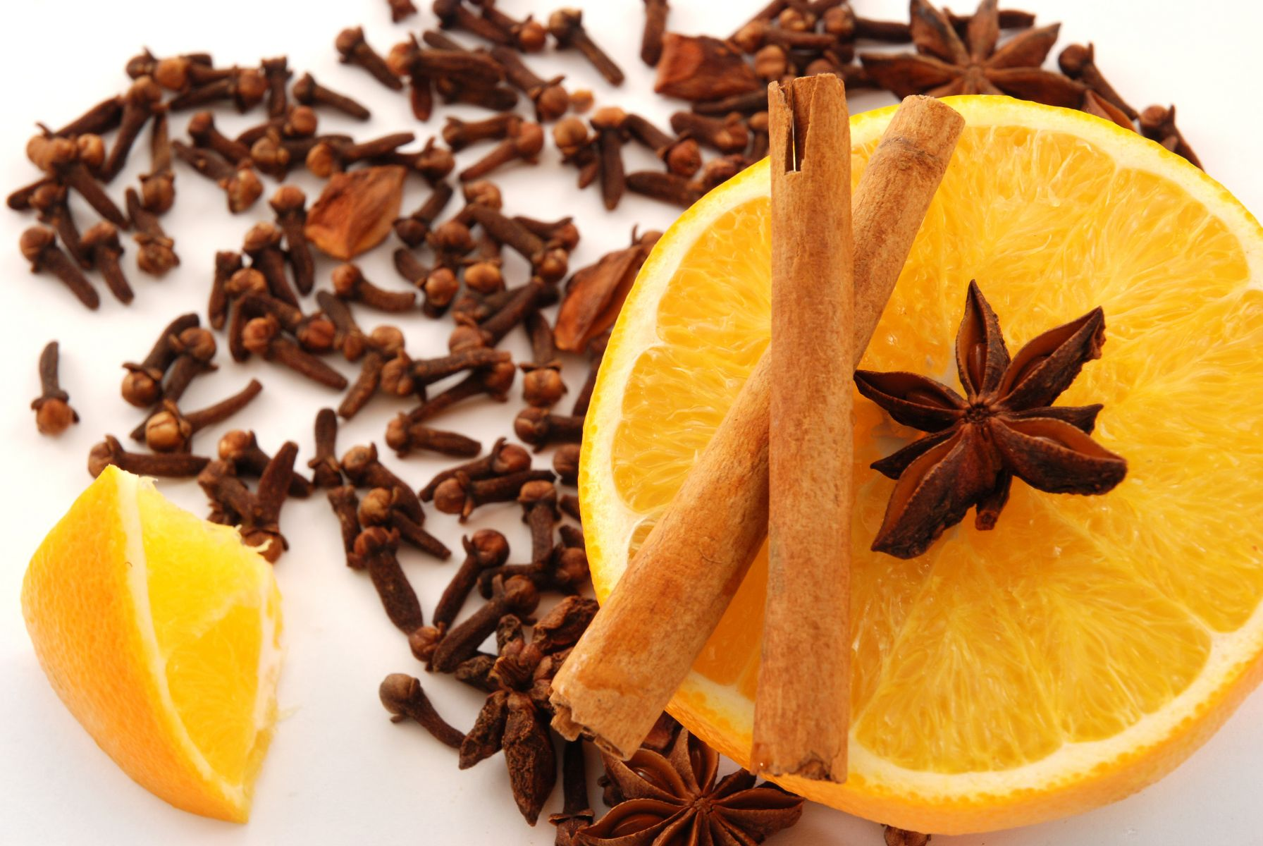 Clove, cinnamon sticks, star anise  and a sliced open orange by © Skoric | Dreamstime.com