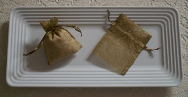 Eucalyptus sachets - scented with aromatherapy essential oil - in green organza bags on a white tray